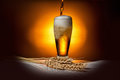 Dark glass beer pouring with ears of wheat on light background, Royalty Free Stock Photo