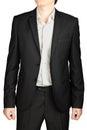 Dark gray evening suit, unfastened blazer, white shirt, no tie.