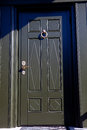 Dark green painted wooden door with golden knob Royalty Free Stock Photo