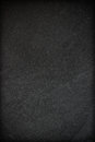 Dark grey, black stone background. Rock texture. Black slate vertical background