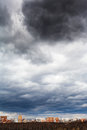Dark grey storm rainy clouds under city in spring Stock Photography