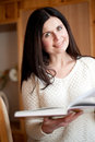 Dark-haired girl reads the book Royalty Free Stock Images