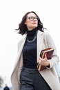 Dark-haired middle-aged woman with books Royalty Free Stock Photo