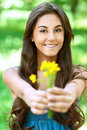 Dark-haired young woman with yellow Royalty Free Stock Photography