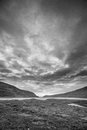 Dark horizons a fjord in iceland with skies above Royalty Free Stock Photography