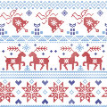 Dark and light blue and red  Scnadinavian Christmas  cross stitch pattern including reindeer, snowflake, star, Xmas tree, bell, pr Royalty Free Stock Photo