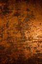 Dark old scary rusty rough golden and copper metal surface texture/background for Halloween or haunted house games background/text Royalty Free Stock Photo