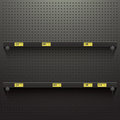 Dark Pegboard Background with shelves and price tags Royalty Free Stock Photo