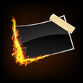 Dark photography picture in fire flames with one side and another side clued with tape on background Stock Photography