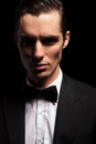 Dark portrait of classy man in tuxedo with bowtie Royalty Free Stock Photo