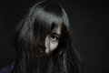 Dark portrait of a pale japanese woman Royalty Free Stock Photo
