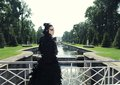 Dark princess on the bridge fashion model posing in summer park Royalty Free Stock Photography