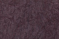 Dark purple wavy background from a textile material. Fabric with natural texture closeup. Royalty Free Stock Photo