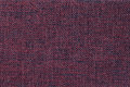 Dark red background of dense woven bagging fabric, closeup. Structure of the textile macro. Royalty Free Stock Photo