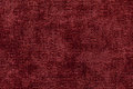 Dark red background from soft textile material. Fabric with natural texture. Royalty Free Stock Photo