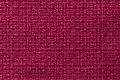 Dark red background from a textile material. Fabric with natural texture. Backdrop. Royalty Free Stock Photo