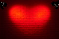 Dark red brick wall with heart shape light effect and shadow, abstract background photo, lighting equipment Royalty Free Stock Photo