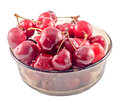 Dark red cherries in a brown transparent bowl isolated white background cutout Stock Images