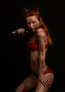 Dark red devil girl with a knife Royalty Free Stock Photo