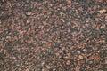 Dark red granite stone background texture closeup Stock Images