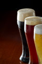 Dark red and light beer served on a bar Royalty Free Stock Images