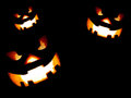 Dark scary jack o lantern on black background Stock Image