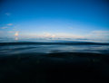 Dark sea and deep blue sky. Double landscape with sea water and sky. Royalty Free Stock Photo