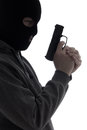 Dark silhouette of burglar or terrorist in mask with gun isolate isolated on white background Royalty Free Stock Images