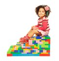 Dark skinned girl and toy blocks Stock Images
