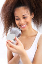 Dark skinned woman reads the face cream young girl smiling while looking under microscope Royalty Free Stock Photos