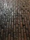 Dark wet slipper worn brick paved road Royalty Free Stock Photo