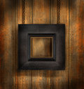 Dark wood frame against wood background Stock Photo