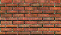Dark worn brick wall seamless background texture Royalty Free Stock Photo