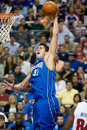Darko milicic dunks the basketball of orlando magic during a game at palace of auburn hills Royalty Free Stock Images