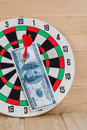 Dart arrow hitting in bulleye on dartboard Royalty Free Stock Photo