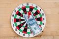 Dart arrow hitting in bullseye on dartboard Royalty Free Stock Photo