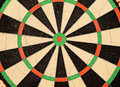 Dart board bullseye target with double rings and red and green Royalty Free Stock Photo