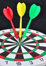 Dart and bull's eye Stock Image