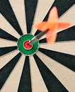 Dart in bulls eye Royalty Free Stock Image