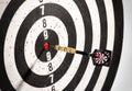 Dart in the bulls eye center of a dart board Royalty Free Stock Photo