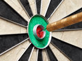 Dart bullseye closeup of a sitting in the of the board Royalty Free Stock Images
