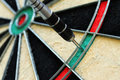 Dart and dartboard close up view of Stock Photography