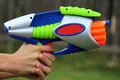 Dart gun close up view of a plastic multicolored Stock Photos