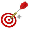 Dart hitting the center mark on target Stock Images