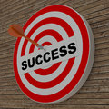 Dart hitting success center target on dartboard brick background Stock Images