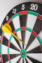 Dart hitting target a yellow a dartboard Royalty Free Stock Image