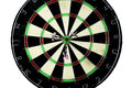 Dart strikes the bulls eye of a dartboard wide shot board from below three darts with Stock Photography
