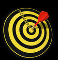 Dart on target center red and gold board Royalty Free Stock Images