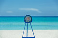 Dart target metal stand on tropical beach and ocea frame standing beautiful gorgeous white sand against tranquil azure ocean blue Stock Image