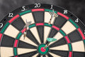Dartboard and arrows plastic front with Royalty Free Stock Image